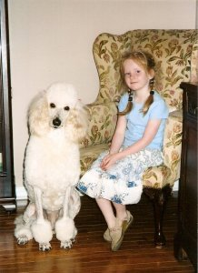 Our daughter Lexie with Enya our female cream Poodle