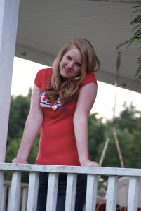 Daughter Lexie leaning on the porch railing.
