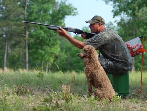 Rick in training with one of our poodles.